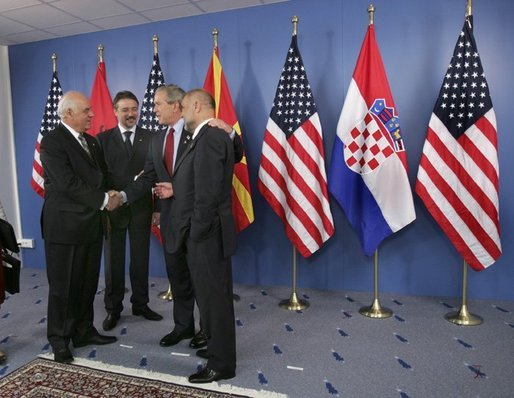 President George W. Bush talks with leaders of the Adriatic Charter Countries following a photo opportunity at the NATO Summit in Istanbul, Turkey, June 29, 2004. From left are President Alfred Moisiu of Albania, President Branko Crvenkovski of Macedonia and President Stjepan Mesic of Croatia. White House photo by Eric Draper.