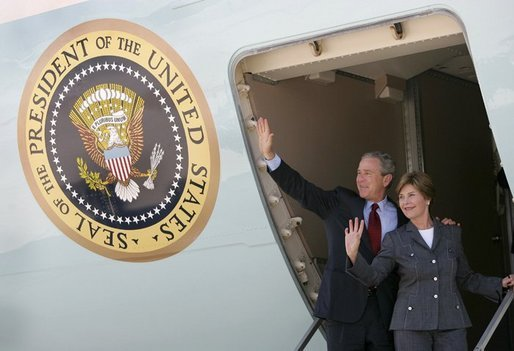President George W. Bush and Mrs. Laura Bush wave from Air Force One as they depart Ataturk International Airport in Istanbul, Turkey, Turkey, Tuesday, June 29, 2004. White House photo by Eric Draper.
