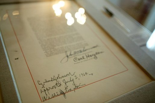 The last page of the Civil Rights Act with the signature of President Lyndon B. Johnson was on display in the White House for a reception commemorating the 40th Anniversary of the Civil Rights Act on July 1, 2004. White House photo by Paul Morse