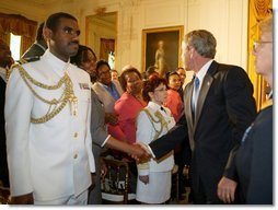 President George W. Bush greets the audience during a reception commemorating the 40th Anniversary of the Civil Rights Act at the White House on July 1, 2004.  White House photo by Paul Morse