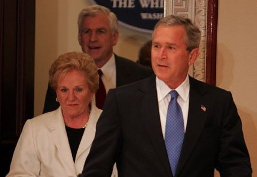 President George W. Bush enters with Sally and Senator John Danforth before the swearing-in ceremony for Senator Danforth as the new representative of the United States to the United Nations in the Eisenhower Executive Office Building on July 1, 2004. White House photo by Paul Morse