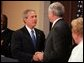 President George W. Bush congratulates Senator John Danforth as the new representative of the United States to the United Nations after a swearing-in ceremony in the Eisenhower Executive Office Building on July 1, 2004. White House photo by Paul Morse