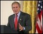 President George W. Bush delivers remarks on the economy in the East Room, Friday, July 2, 2004. White House photo by Eric Draper