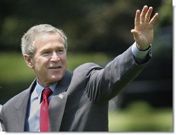 President George W. Bush waves as he departs the South Lawn for Camp David, Friday, July 2, 2004.  White House photo by Eric Draper