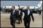 President George W. Bush arrives in Raleigh, North Carolina with Congressman Richard Burr on Wednesday July 7, 2004. The President was in North Carolina to meet with pending North Carolina judicial nominees. White House photo by Paul Morse