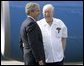 President George W. Bush chats with Freedom Corps greeter Scotty Maconochie after landing in Waterford, Michigan on Wednesday July 7, 2004. White House photo by Paul Morse