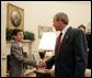 President George W. Bush welcomes the 2004 Scripps Howard Spelling Bee champion, David Tidmarsh, 14, of South Bend, Ind., to the Oval Office, Thursday, July 8, 2004. David bested 265 other contestants from across the nation to win the prestigious spelling honors. He is the first student from Indiana to win the contest in 76 years. White House photo by Eric Draper.