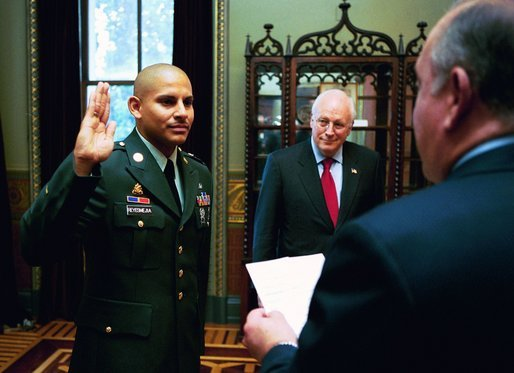 Vice President Dick Cheney attends the U.S. Citizenship Ceremony for Army Sergeant Isaac Reyes-Meija of Lima, Peru, in the Vice President's Ceremonial Office in the Dwight D. Eisenhower Executive Office Building Thursday, July 8, 2004. White House photo by David Bohrer.