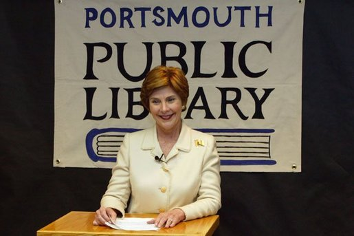Laura Bush answers reporters questions after participating in the No Child Left Behind Summer Reading Program with local children at the Portsmouth Public Library in Portsmouth, New Hampshire, Friday, July 9, 2004. White House photo by Yoni Brook