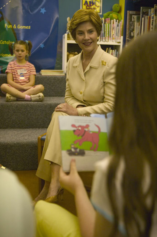 Laura Bush listens to children read while participating in the No Child Left Behind Summer Reading Program at the Portsmouth Public Library in Portsmouth, New Hampshire, Friday, July 9, 2004. White House photo by Joyce Naltchayan