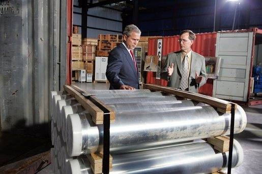 President George W. Bush and Jon Kreykes of the National Security Advanced Technologies group, look over equipment obtained from Libya's former nuclear weapons program at the Oak Ridge National Laboratory in Oak Ridge Tenn., Monday, July 12, 2004. White House photo by Tina Hager