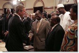 After signing into law the African Growth and Opportunity Act (AGOA) Acceleration Act of 2004, President George W. Bush meets with ceremony attendees in the Dwight D. Eisenhower Executive Office Building Tuesday, July 13, 2004.  White House photo by Paul Morse