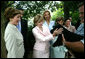 Laura Bush and Ana Ligia Mixco Sol de Saca, wife of President Antonio Saca of El Salvador, greet Barney, the Bush family's dog, after having coffee at the White House Tuesday, July 13, 2004. White House photo by Joyce Naltchayan