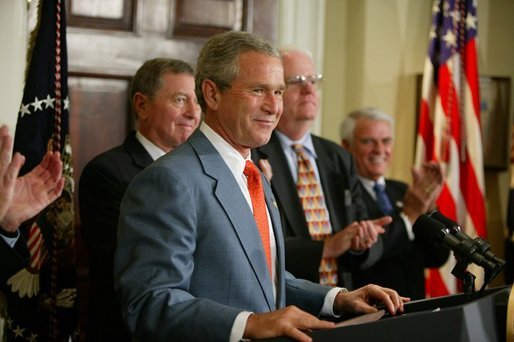 "President George W. Bush is applauded during his remarks at the signing ceremony for the Identity Theft Penalty Enhancement Act in the Roosevelt Room of the White House Thursday, July 15, 2004. ""The Identity Theft Penalty Enhancement Act also prescribes prison sentences for those who use identity theft to commit other crimes, including terrorism. It reflects our government's resolve to answer serious offenses with serious penalties,"" said the President. White House photo by Paul Morse"