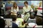 Laura Bush and her daughter Jenna read with a second grade class at Hueytown Elementary School in Birmingham, Ala., Wednesday, July 14, 2004. White House photo by Joyce Naltchayan