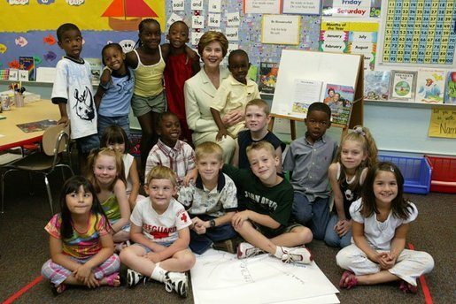 Laura Bush poses for a photo with students during a visit to Hueytown Elementary School in Birmingham, Alab., Wednesday, July 14, 2004. White House photo by Joyce Naltchayan