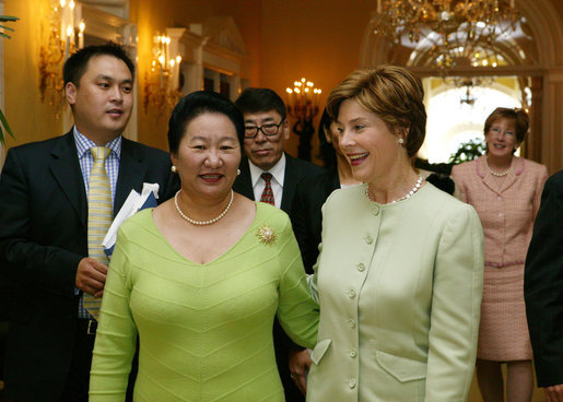 Laura Bush greets Azadsurengiin Oyunbileg, wife of President Natsagiyn Bagabandi of Mongolia, in the Yellow Oval Room Friday, July 16, 2004. White House photo by Joyce Naltchayan