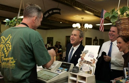 President George W. Bush chats with Ray Cuttle the owner of the La Tropicana Café in Ybor City, Florida on Friday July 16, 2004. White House photo by Paul Morse