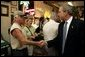 President George W. Bush visits with patrons of La Tropicana Café in Ybor City, Florida on Friday July 16, 2004. White House photo by Paul Morse