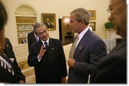 President George W. Bush and Prime Minister Abdullah Badawi of Malaysia meet in the Oval Office Monday, July 19, 2004. Also pictured are National Security Advisor Dr. Condoleezza Rice, left and Secretary of State Colin Powell.  White House photo by Tina Hager
