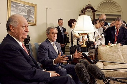 "President George W. Bush and President Ricardo Lagos of Chile meet in the Oval Office Monday, July 19, 2004. ""One of the things that has worked well is the free trade agreement with Chile, and we talked about that today,"" said President Bush. White House photo by Paul Morse."