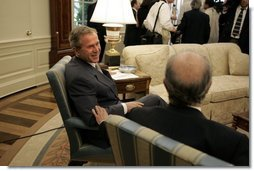 President George W. Bush and President Ricardo Lagos of Chile talk after meeting with the press in the Oval Office Monday, July 19, 2004.  White House photo by Paul Morse