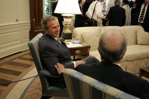 President George W. Bush and President Ricardo Lagos of Chile talk after meeting with the press in the Oval Office Monday, July 19, 2004. White House photo by Paul Morse.