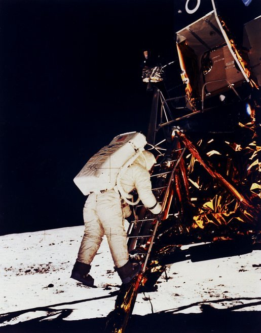 Buzz Aldrin climbs down the Eagle's ladder to the surface. Click for larger image. Photo credit: NASA.