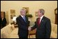 President George W. Bush meets with Prime Minister Adrian Nastase of Romania in the Oval Office Wednesday, July 21, 2004 White House photo by Eric Draper.