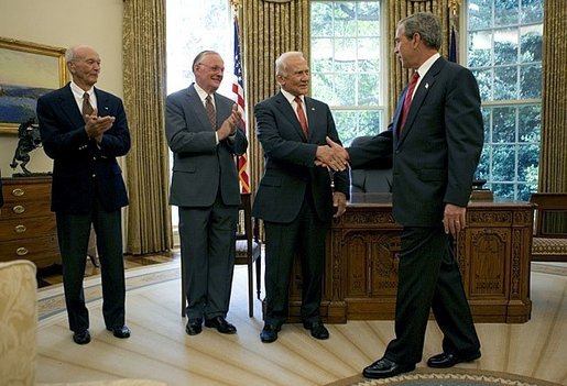 President George W. Bush welcomes Apollo 11 Astronauts Michael Collins, left, Neil Armstrong, center, and Buzz Aldrin to the Oval Office Wednesday, July 21, 2004. The astronauts visited the White House to mark the 35th anniversary of the successful Apollo 11 mission of landing on the moon, walking along its surface and safely returning home White House photo by Eric Draper.