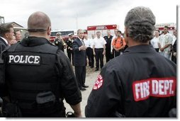 President George W. Bush addresses police and firemen after a demonstration by first responders at Northeastern Illinois Public Training Academy in Glenview, Illinois on Thursday July 22, 2004.  White House photo by Paul Morse