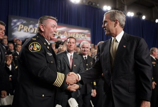 President George W. Bush greets firemen after remarks on homeland security at Northeastern Illinois Public Training Academy in Glenview, Illinois on Thursday July 22, 2004. White House photo by Paul Morse.