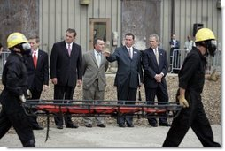 President George W. Bush observes a demonstration by first responders at Northeastern Illinois Public Training Academy in Glenview, Illinois on Thursday July 22, 2004.  White House photo by Paul Morse