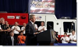 President George W. Bush receives applause during remarks on homeland security at Northeastern Illinois Public Training Academy in Glenview, Illinois on Thursday July 22, 2004.  White House photo by Paul Morse