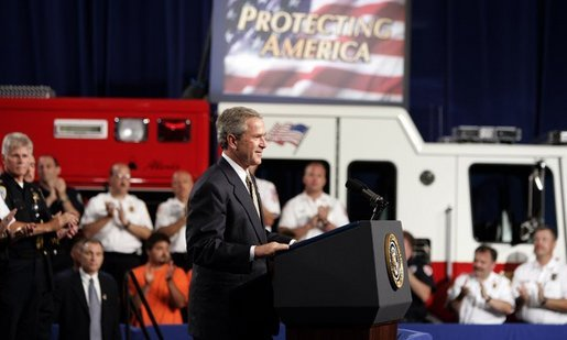 President George W. Bush receives applause during remarks on homeland security at Northeastern Illinois Public Training Academy in Glenview, Illinois on Thursday July 22, 2004. White House photo by Paul Morse.