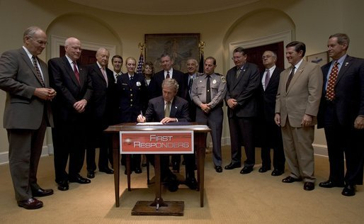 "President George W. Bush signs H.R. 218, the Law Enforcement Officers Safety Act of 2004,"" which exempts qualified active and retired law enforcement officers from State laws that prohibit the carrying of concealed firearms, in the Roosevelt Room Thursday, July 22, 2004. White House photo by Tina Hager."