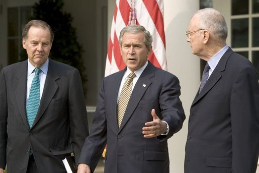 Accompanied by Chairman Thomas Kean, left, and Vice Chairman Lee Hamilton of the 911 Commission, President George W. Bush addresses the press during the presentation of the Commission's report in the Rose Garden Thursday, July 22, 2004. White House photo by Eric Draper.