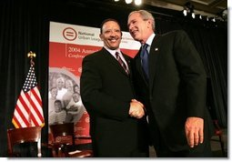 President George W. Bush greets Marc Morial, President of the National Urban League, after delivering his remarks in Detroit, Mich., Friday, July 23, 2004.  White House photo by Eric Draper