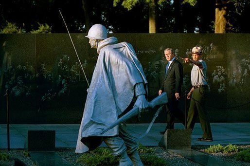 President George W. Bush and U.S. Park Ranger Lance Hatten tour the Korean War Veterans Memorial in Washington, D.C., Friday, July 25, 2003. Marking the 50th anniversary of the signing the armistice that ended the Korean war July 27, 1953, President Bush visited the memorial to honor those who served in the conflict. File Photo. White House photo by Paul Morse.