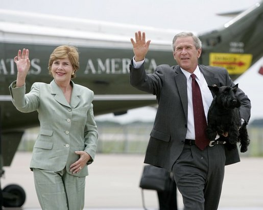 President George W. Bush and Mrs. Bush wave as they walk to Air Force One with Barney before departing Waco, Texas, Thursday, July 29, 2004. White House photo by Eric Draper.