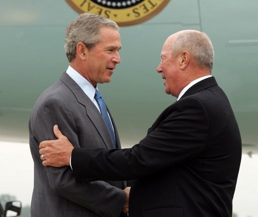 President George W. Bush chats with Freedom Corps greeter Charlie Graas after touching down in Springfield, Missouri on Friday July 30, 2004. White House photo by Paul Morse.