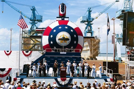 "Laura Bush christens the U.S.S. Texas, a Virginia class submarine, in Newport News, Va., July 31, 2004. ""Today, we celebrate the devoted service of the men and women of the United States Navy and the skill of America's shipbuilders. I'm honored to christen the triumph that is the Texas,"" said Mrs. Bush in her remarks. White House photo by Joyce Naltchayan"