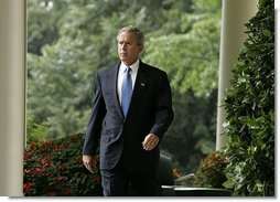 President George W. Bush enters the Rose Garden where he talks about America's intelligence reforms Monday, Aug. 2, 2004.   White House photo by Paul Morse