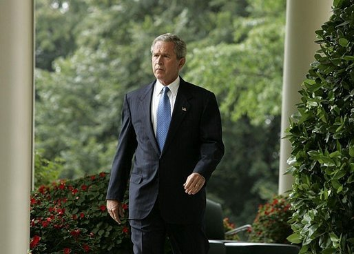 President George W. Bush enters the Rose Garden where he talks about America's intelligence reforms Monday, Aug. 2, 2004. White House photo by Paul Morse.
