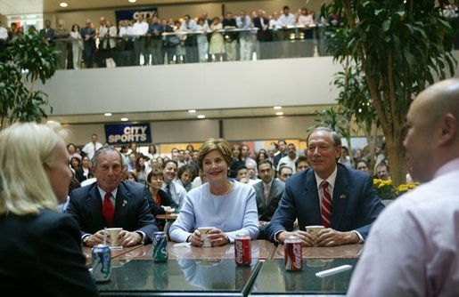 Laura Bush, New York Mayor Michael Bloomberg, left, and Governor George Pataki meet with employees at Citigroup headquarters in New York, N.Y., Monday, Aug. 2, 2004. The Citigroup building is one of five locations identified as a possible terrorist target. White House photo by Joyce Naltchayan.