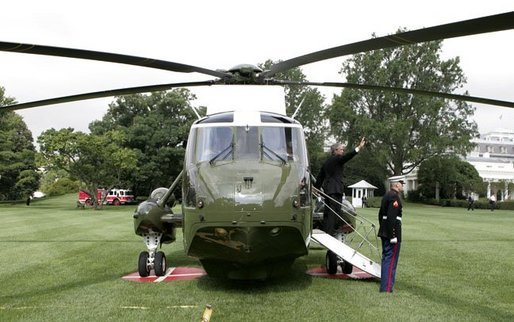 President George W. Bush waves from Marine One upon his departure from the South Lawn Tuesday, Aug. 3, 2004. White House photo by Tina Hager.