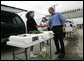 Traveling through Iowa, President George W. Bush stops by a farmers Market in Davenport, Wednesday, Aug. 4, 2004. White House photo by Eric Draper.