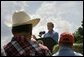 "President George W. Bush talks about expanding the Conservation Reserve Program during a visit to the Katzenmeyer family farm in Le Sueur, Minn., Wednesday, Aug. 4, 2004. ""I'm ordering the Secretary of Agriculture to help protect 250,000 acres of grasslands, which are the home of several species of birds, including the Northern Bobwhite Quail,"" explained the President Bush. ""By expanding this program, our goal is to increase the quail population by about 750,000 birds a year."" White House photo by Eric Draper."
