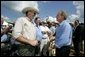 President George W. Bush talks with audience members at the Katzenmeyer family farm in Le Sueur, Minn., Wednesday, Aug. 4, 2004. White House photo by Eric Draper.
