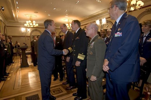 President George W. Bush greets military personnel after signing H.R.4613, The Defense Appropriations Act for Fiscal Year 2005, in the Dwight D. Eisenhower Executive Office Building Thursday, Aug. 5, 2004. White House photo by Eric Draper